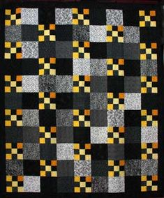 9-Patch on Parade Quilt. I would do the 9-patch blocks with scraps, and this would be a really pretty scrap quilt!