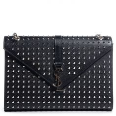 This is an authentic SAINT LAURENT Grain de Poudre Textured Matelasse Studded Large Monogram Satchel in Black- NEW. This stylish shoulder bag crafted of black grain de poudre textured leather completely lined with small silver studs.
