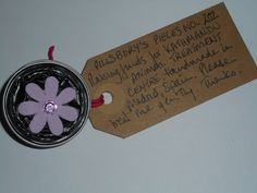 Pillsbury's Pieces No, 202. Pin with black capsule with lilac  flower. In exchange for a donation to KATHMANDU ANIMAL TREATMENT CENTRE, Nepal. Available at St. George's Church, Madrid on Saturday 13 June from 11.00 - 15.00.