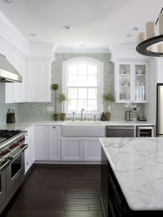 French country kitchen with a modern twist. Might be too sterile - consider warming it up with accent colors.