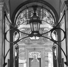 Light above entrance gate to the Royal Exchange, photo John Gay (1909-99). London, England, c.1940.