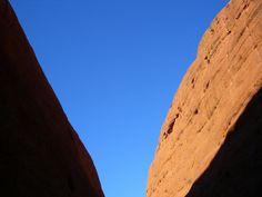 Blue sky contrast with the reddish orange rocks of the Olgas. Australia.