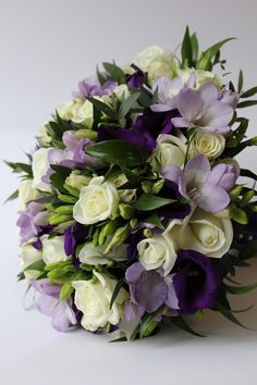 Bridal Bouquet of dark purple Lisianthus, lilac Freesia and ivory Roses