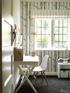Thomas' bedroom overlooks the back garden; the wallpaper is Woods by Cole & Son