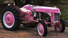 Yeah a Pink tractor to go in my Pink Barn, wearing my Pink overalls and Pink checked boots.  See me smile