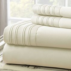 Features:  -Set includes 1 flat sheet, 1 fitted sheet and 2 pillowcases.  -Construction Material: 55% Cotton and 45% polyester.  -Pleated hem on flat sheet and pillowcases.  -Fully elasticized fitted