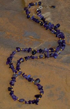 "Amethyst nuggets and chips, 14 kt gold-filled beads and chain. Necklace is approximately 36"" in length, with a 3"" extender. Perfect for layering."