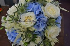 Gorgeous bridal bouquet in sea shades x