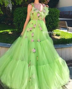 Details - Green Lime dress color - Tulle dress fabric - Handmade embroidered pink flowers all over the dress with a green velvet ribbon - A-line gown with V-neck - For parties and special occasions Elegant Dresses For Women, Lovely Dresses, Modest Dresses, Beautiful Gowns, Formal Dresses, Lime Green Prom Dresses, Green Dress, Hijab Evening Dress, Evening Dresses