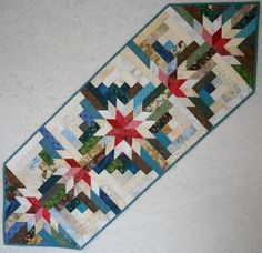 Nice runner! Timberline Log Cabin table runner. The pattern is from Judy Martins Log Cabin Quilt Book.