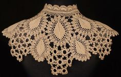 "This is an antique collar or neck piece that is hand made of crochet lace. The lace is in an ecru colour and dates to either the Victorian or Edwardian eras. It measures 9"" in height at the center poi"