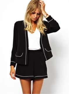 Very cute black blazer and skirt. A bit Chanel!