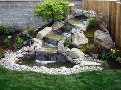 cascade bassin de jardin -roches-cailloux-plantes-vivaces