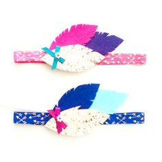 This trendy feather headband will look adorable in your little girls hair! This headband is made from soft wool felt and glittery goodness attached to an adorable arrow elastic.  Gracie Lou Boutique headbands are made with soft elastics to fit gently on your little ones head. Each headband is handmade with love and grace and will ship within 2 weeks. Colors may vary slightly than what appears on screen. Also available as a hair clip.