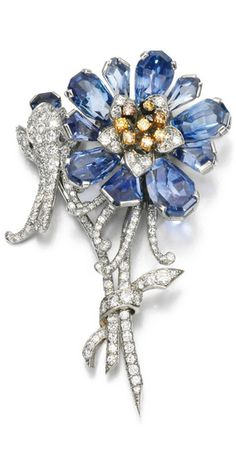 Sapphire and diamond brooch Of floral design, set with pear- and shield-shaped sapphires, circular- and single-cut diamonds, the stamen set with similarly cut diamonds of yellow and brown tint, numbered.