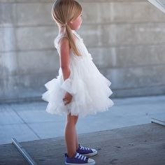Fluffy dress + Converse sneaks.