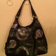 Coach Legacy Large metallic black/grey legacy bag has three separate sections of the bag with the zipper in the middle. Snap button in the front and back of bag. Size 13 L x 14 W. Shoulder strap. Dust bag. Coach Bags