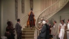 Google Image Result for http://hookedonhouses.net/wp-content/uploads/2010/08/Auntie-Mame-staircase-611x343.jpg