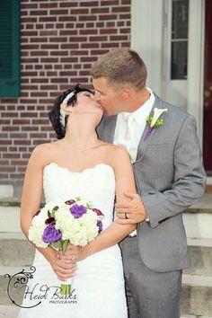 Bride and groom kiss - wedding pose Heidi Burks Photography