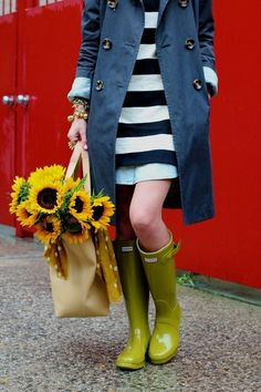 trench coat. striped dress. rain boots. sunflowers. perfection