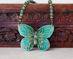 Butterfly pendant necklace-green turquoise hand by ZoesBeadGarden