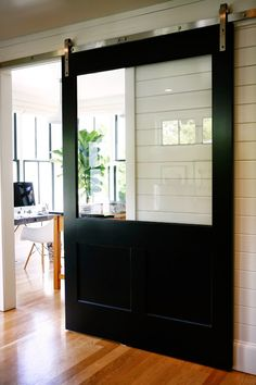 HouseTour:ModernFarmhouse - Design Chic A sliding barn door with a window! I like that you can see the view with the doors closed. House Design, House, Interior, Home, House Styles, New Homes, Doors Interior, House Interior, Interior Design