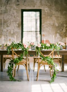 Garland covered chairs | Photography: Marta Locklear - martalocklear.com  Read More: http://www.stylemepretty.com/2014/07/16/loft-style-wedding-inspiration/