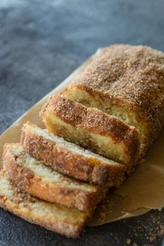 Cinnamon Swirl Donut Bread...A sweet cakey loaf with a delicious cinnamon swirl baked until perfection and then dipped into lots of butter and coated with cinnamon and sugar!! YESSSSS.