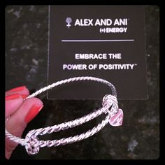 Alex and Ani Silver Twisted Bangle For sale is a beautiful Alex and  Ani silver bangle. It is a shinier silver finish than the regular bangles. It has a twisted look to it. It does not stretch as much as the regular bangles, it is rather stiff so please be aware of that fact before you make an offer. It looks beautiful with many of the Alex and Ani bangles! Worn once!!!! Box included. Alex & Ani Jewelry Bracelets