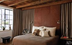 The moody bedroom furnished with Ralph Lauren Home fabrics, and an African stool I am coveting.
