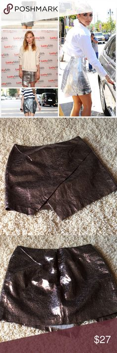 Flash Sale🎉🎉🎉ASTR Metallic Mini Skirt ASTR brand metallic skirt size 5/6 never worn new without tags the biggest look this season on the runways has been anything metallic this skirt reminds me of the Isabel Marant Collection for this summer like identical that she is selling. Bought at Nordstrom only listed in Zara for search results. Zara Skirts