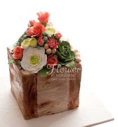 Rose & Succulent Flower Box - This cake was for a lady who does floral arraigning and belongs to a succulent club which was perfect for me as I love creating and arranging sugar flower! All flower are hand made out of gum paste then coloured with petal dusts. The wood effect on the case was created by brushing chocolate onto a ganache coated cake.
