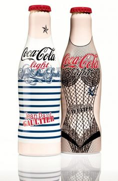 "The two bottles were designed by Gaultier, and feature two iconic marks that make them his: the smock, and lingerie. They are also similar to his perfume bottles, ""Le Male"" and ""Classique."""