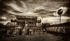 Sometimes, an HDR image of a cool place can come out a little boring, even in an interesting place such as this.  So, often times I will run the image through a black and white treatment which can help take a boring photo and make it more interesting.  - Angkor Wat, Cambodia  - Photo from #treyratcliff Trey Ratcliff at http://www.StuckInCustoms.com