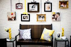 Hanging photo frames + yellow and gray pillows = beautiful