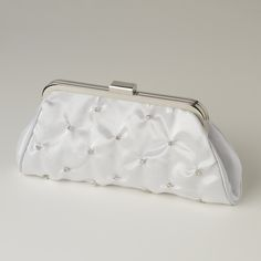 This fabulous rhinestone embellished white satin evening bag with silver  plating is absolutely stunning.  Clasp opens to side pocket inside with  chain that can be added on or used without.  This is perfect to add a  touch of glamour to your evening night outSize: 9 Length  5 Height 1 Width
