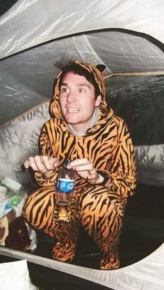 Dan Smith of Bastille... inside a tent wearing a tiger costume and holding a water bottle. Oh you cute little weirdo you.