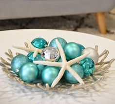 Decorating with Christmas Ball Ornaments Coastal Style: http://www.completely-coastal.com/2011/12/ideas-for-christmas-balls-decorations.html
