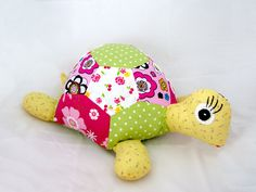 This adorable softie turtle, made from 100% cotton - Green, yellow and pink cotton.  Filled with new polyester stuffing...very light.