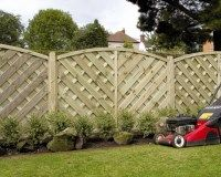Elite St Lunairs Decorative Fence Panel. A high quality pressure treated decorative wooden garden panel with cross hatch lattice design and arched top available in 1.2m & 1.8m heights £53.58. #ArchTopFencePanels #DecorativeFencePanels #GardenFencePanels