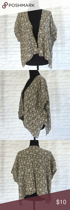Brandy Meville Printed Kimono Inseam on the front of the cardigan is begin to pull apart- however still very wearable. Brandy Melville Tops