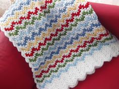 """C O L O R !                    The pattern is from Churchmouse Yarns and Teas :   """" Vintage Rippl e Afghan """"   Extra rows of white were ..."""