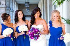 Blue Bridesmaids w/ white bouquets....bride w/ colorful bouquet