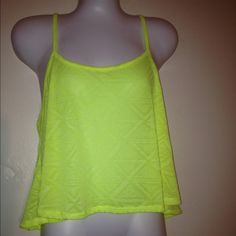Neon yellow tank top Neon yellow tank top so cute for the spring summer. Dress it up or down Tops Tank Tops