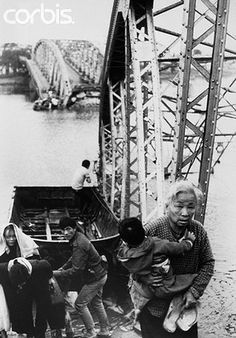 1968, near Hue, South Vietnam --- The old and the young flee Tet offensive fighting in Hue, managing to reach the south shore of the Perfume River despite this blown bridge, 1968. --- Image by © CORBIS.  #VietnamWarMemories