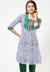 A white coloured kurta for women from Anahi. Made from cambric, this printed kurta features a knee length, 3/4th sleeves and a round neck.