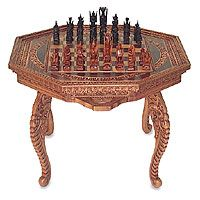 Wood chess set, 'Into Battle'  £273.57  The game of chess flourishes as a true art form in this folding table set with detachable legs by Ketut Sandi. Each eye-catching piece represents a Balinese god and invites close inspection and admiration. The rectangular table's intricate detail and elegant design deserve a special place in any sitting room. Carved from local cempaka wood, this timeless set will spark inspiration in expert, amateur and all those with a fine eye for beauty.    An…
