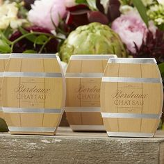 Perfect for vineyard, country and fall theme wedding favors, these adorable favor 2 x 3 favor boxes look just like oak wine barrels with shiny silver hoop bands and the words Bordeaux Chateau on the front and back for presenting small treats and treasures to your wedding reception guests. These favor boxes can be ordered at http://myweddingreceptionideas.com/wine-barrel-favor-boxes.asp