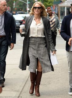 On set: Wearing a twill woolen skirt and cream silk blouse, the Mulholland Drive star wore...