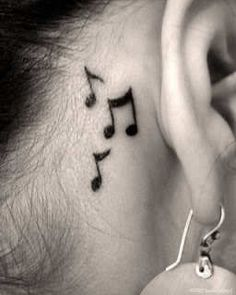 """<3  I think this may be my """"big thing"""" I decide to do for my 25th bday...  tatoo behind the ear.  =)"""